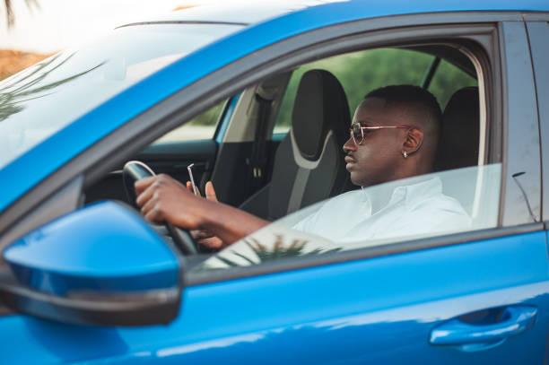 Business man using phone driving stock photo