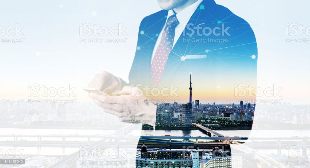 Business man using smart phone, double exposure effect stock photo