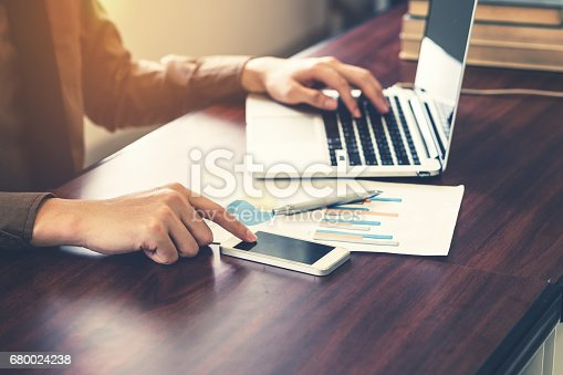 1016971522istockphoto business man using smartphone in the office with sunlight. 680024238