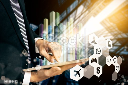 istock business man using  tablet computer and modern technology concept 1161893462