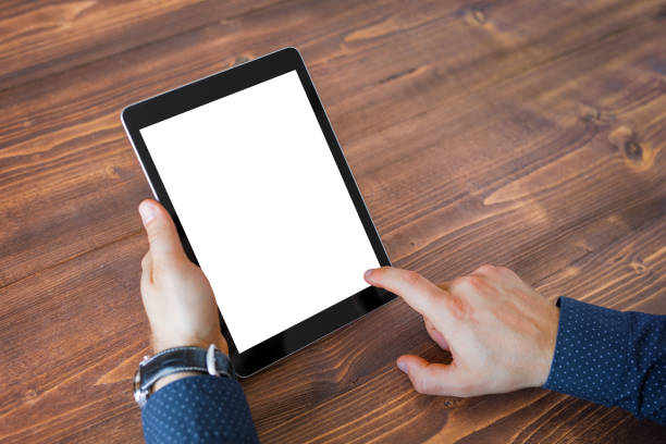 Business man using tablet computer. Tablet horizontal screen mockup. stock photo