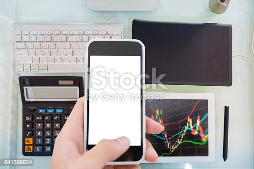 istock Business man using  technical equipment analysis market and finance economic 641398624