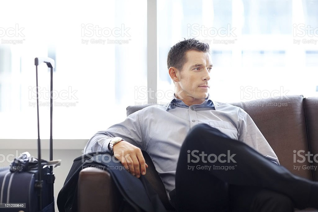 Business man waiting for his flight at airport stock photo