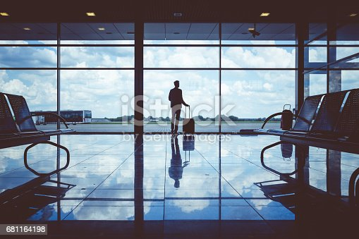 494216846 istock photo Business man waiting to board a flight in airport 681164198