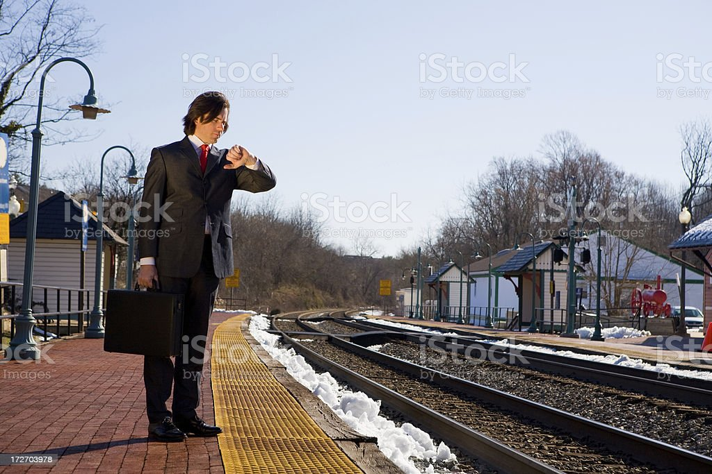 Business Man Waits for Train royalty-free stock photo