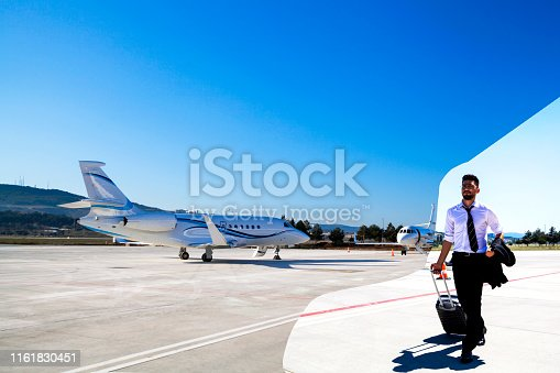 Business Man Walking on airport and private plane
