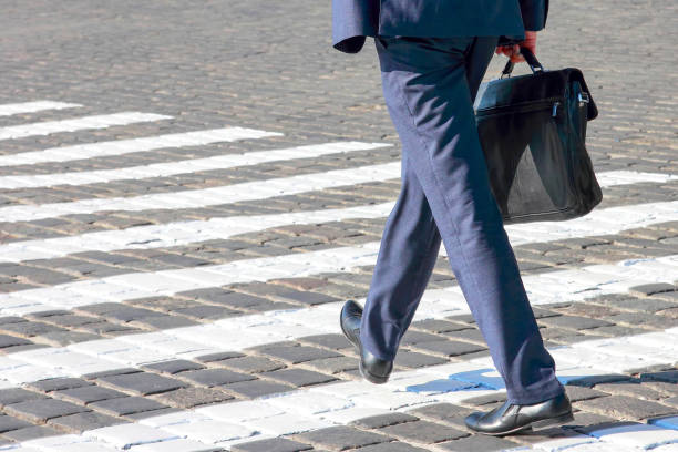 business man walks on a pedestrian crossing. Goal and success stock photo