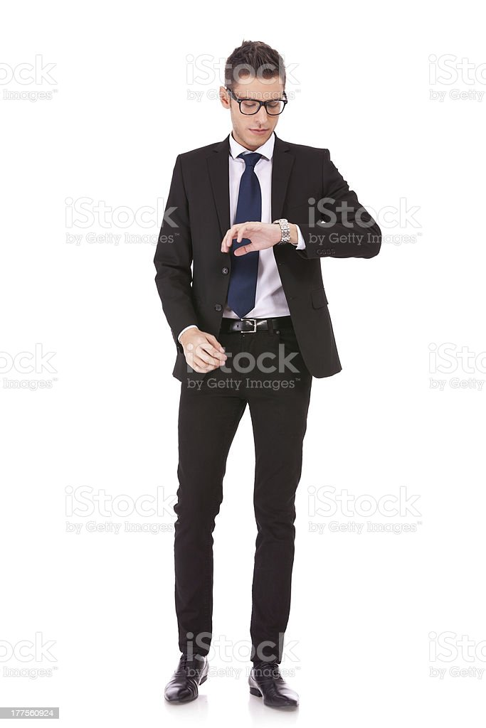 business man wearing glasses looking at watch royalty-free stock photo