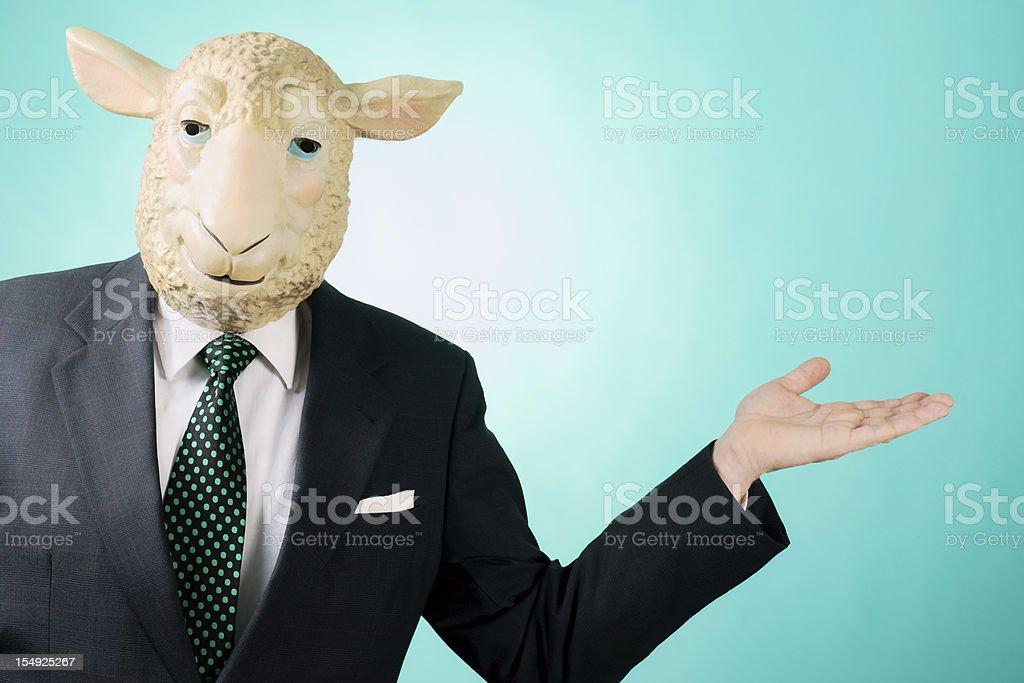 Business man wearing sheep mask presenting. stock photo
