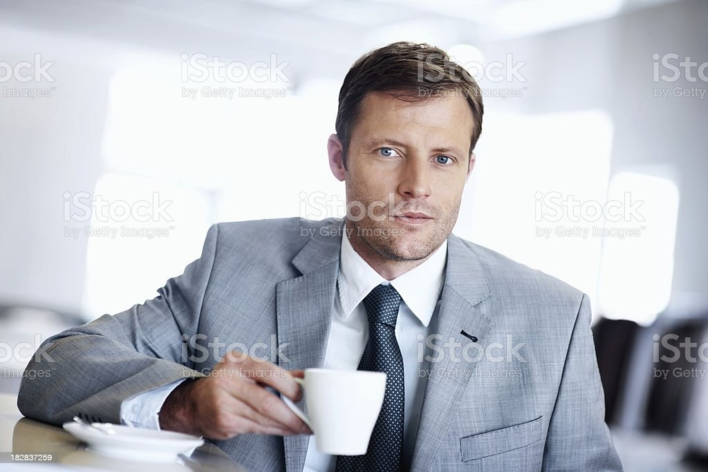 Business man with a cup of tea against blurred background royalty-free stock photo