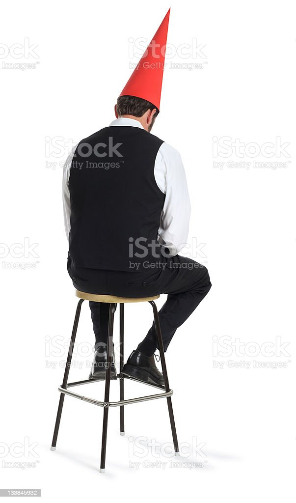 Business Man with a Dunce Hat stock photo