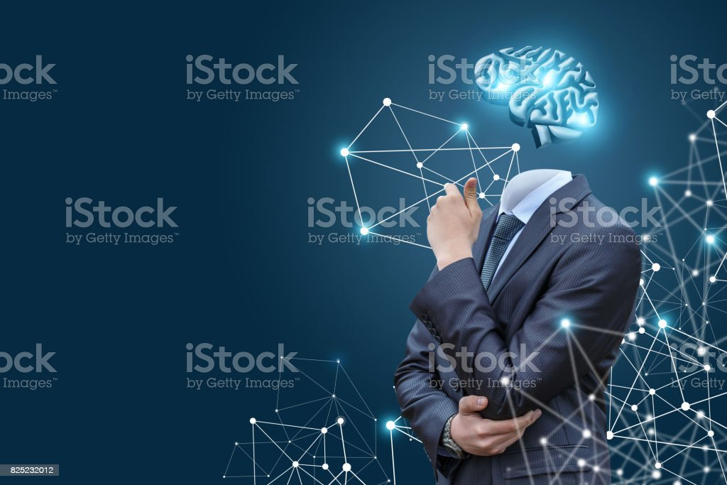Business man with a model of the brain . stock photo