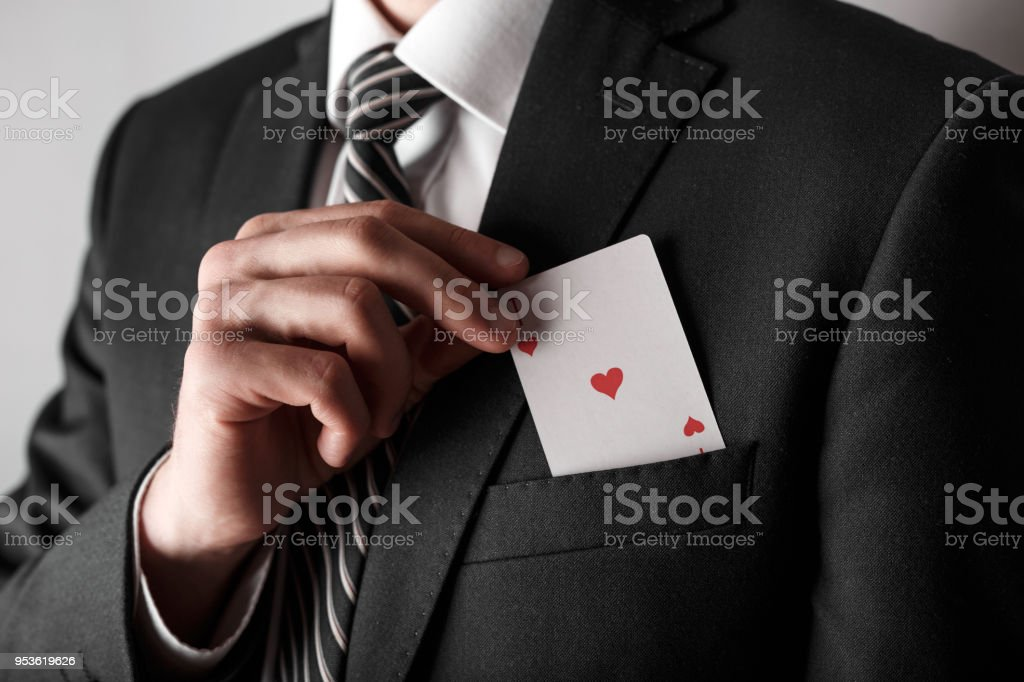 Business man with ace in the pocket of his jacket. stock photo