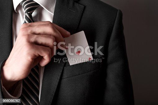 istock Business man with ace in the pocket of his jacket. 956066262