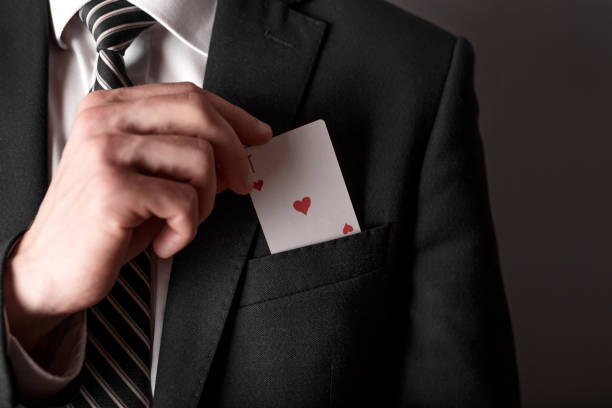Business man with ace in the pocket of his jacket. Business man with ace in the pocket of his jacket. magic trick stock pictures, royalty-free photos & images