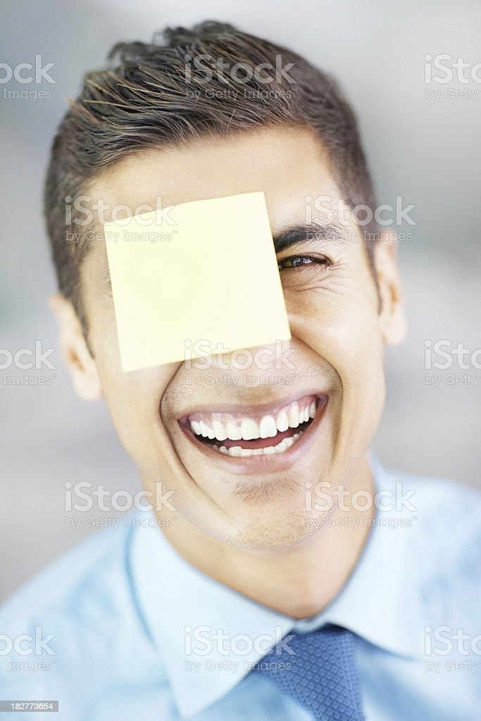 Business man with adhesive note stuck to forehead royalty-free stock photo