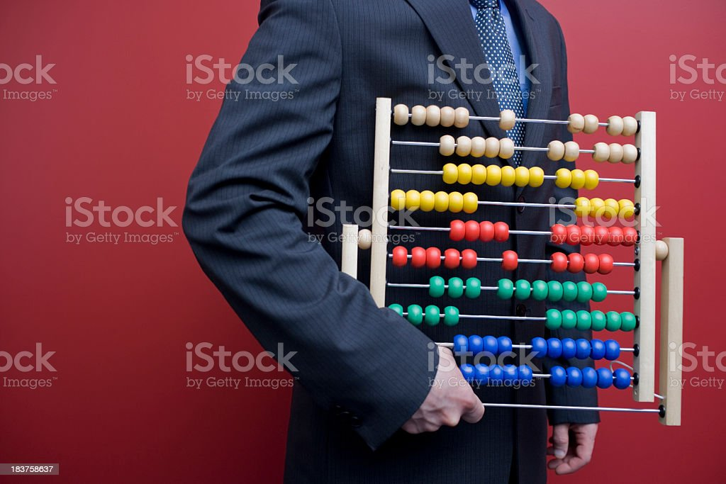 Business man with an abacus royalty-free stock photo