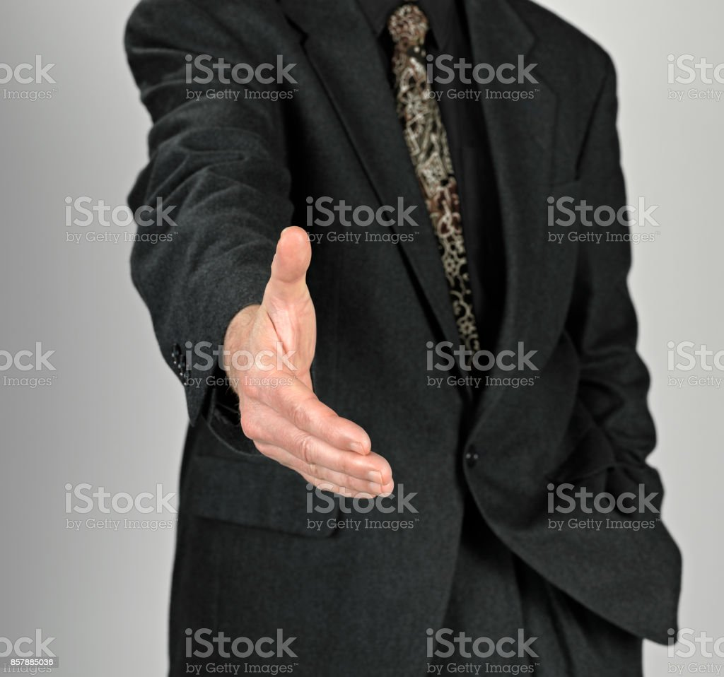 Business man with an open hand stock photo