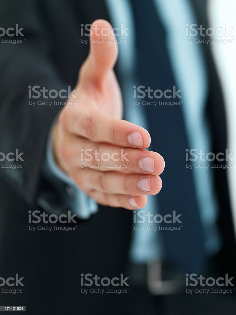 Business man with an open hand ready to seal a deal royalty-free stock photo
