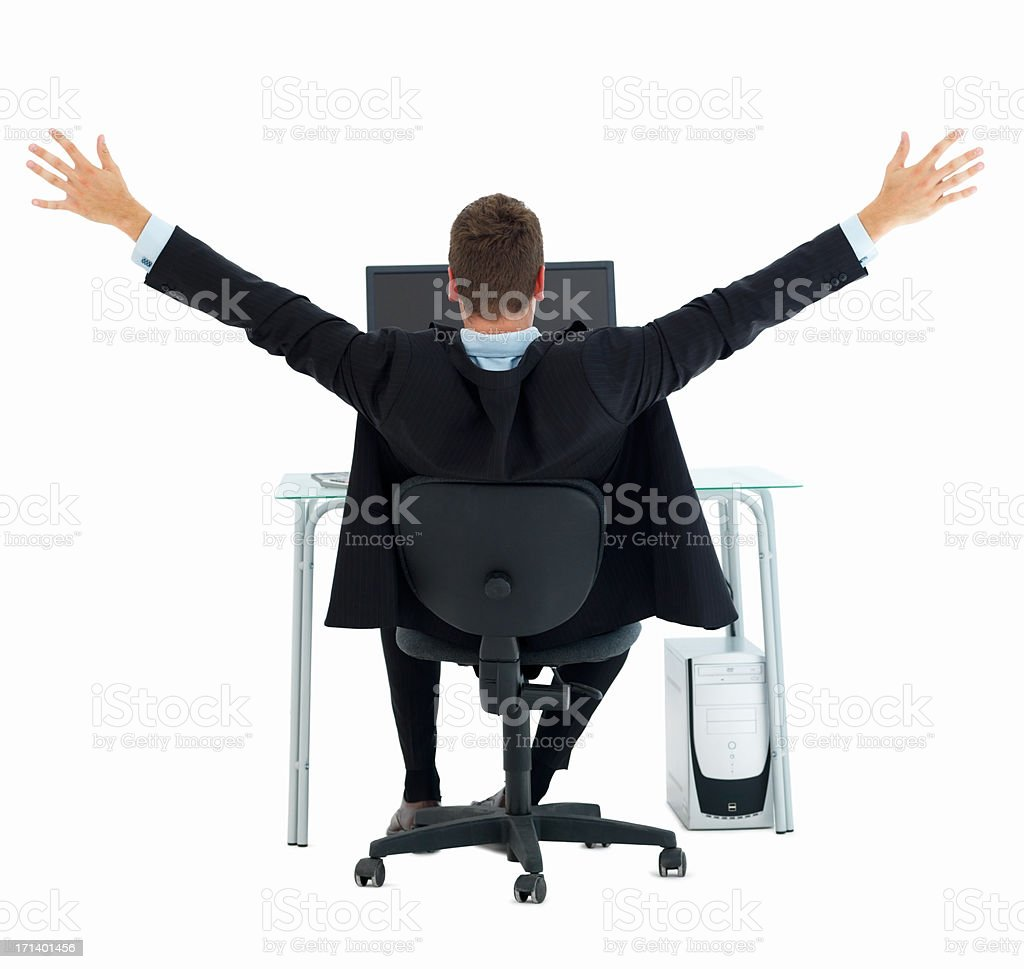 Business man with arms raised in excitement at office desk isolated on white royalty-free stock photo