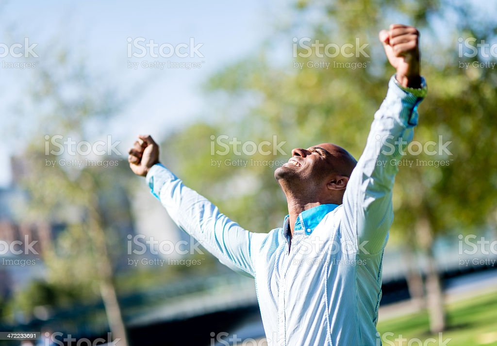 Business man with arms up stock photo