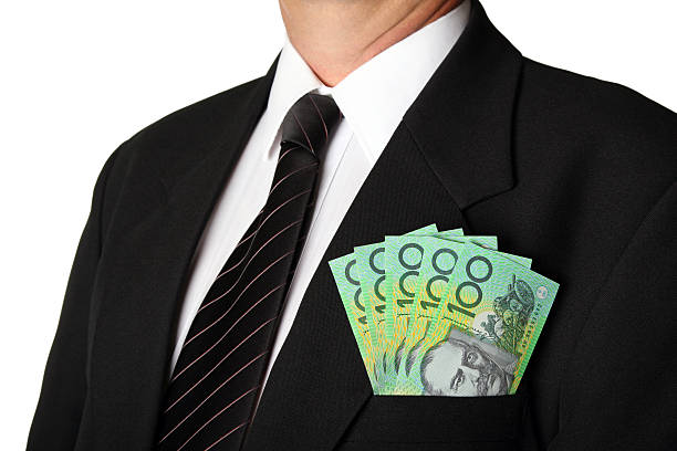 Business Man with Australian Money in his pocket white background stock photo