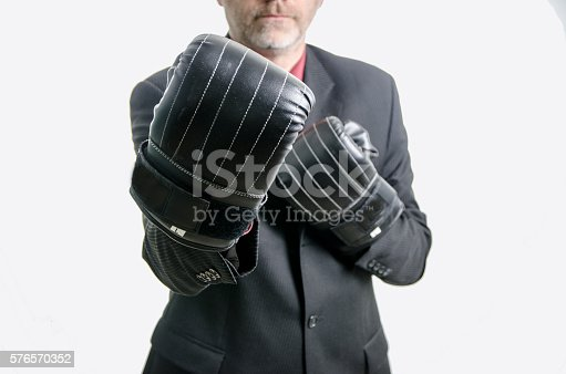464164875 istock photo Business man with boxing gloves 576570352
