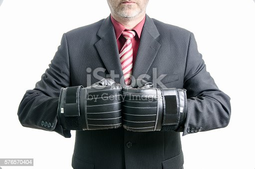 464164875 istock photo Business man with boxing gloves 576570404