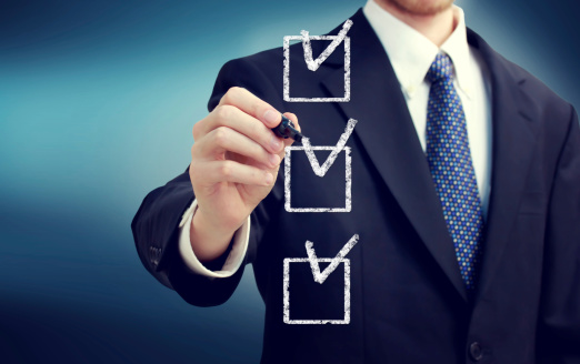 Business Man With Checkboxes Stock Photo - Download Image Now