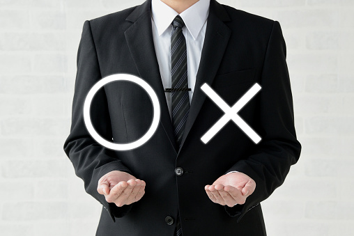 istock Business man with circle and cross signs 1145395716
