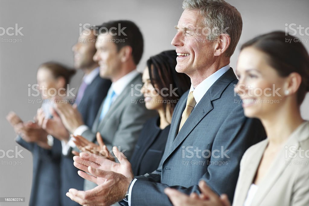 Business man with colleagues clapping for a good presentation royalty-free stock photo