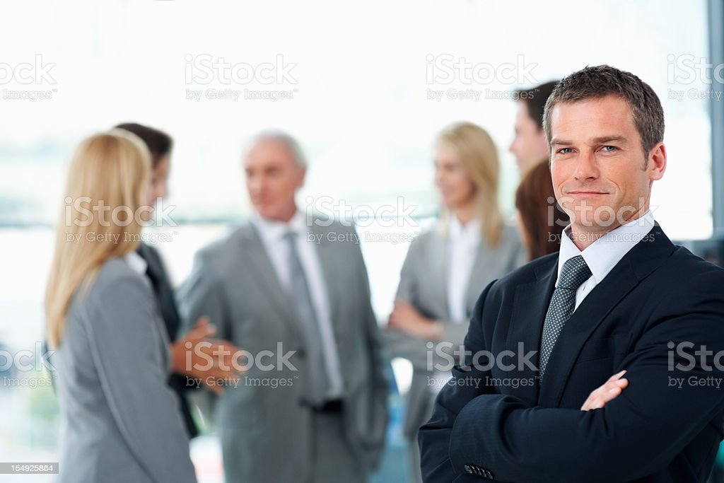 Business man with colleagues discussing in background royalty-free stock photo