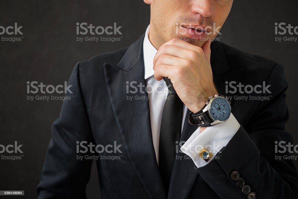 Business man with fancy wrist watch stock photo