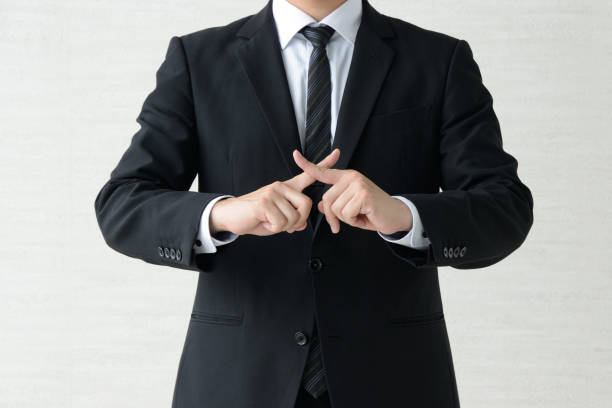 Business man with fingers crossed Business man with fingers crossed failure stock pictures, royalty-free photos & images