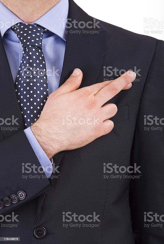 Business man with fingers crossed. royalty-free stock photo
