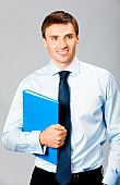 istock Business man with folder, on gray 142248498
