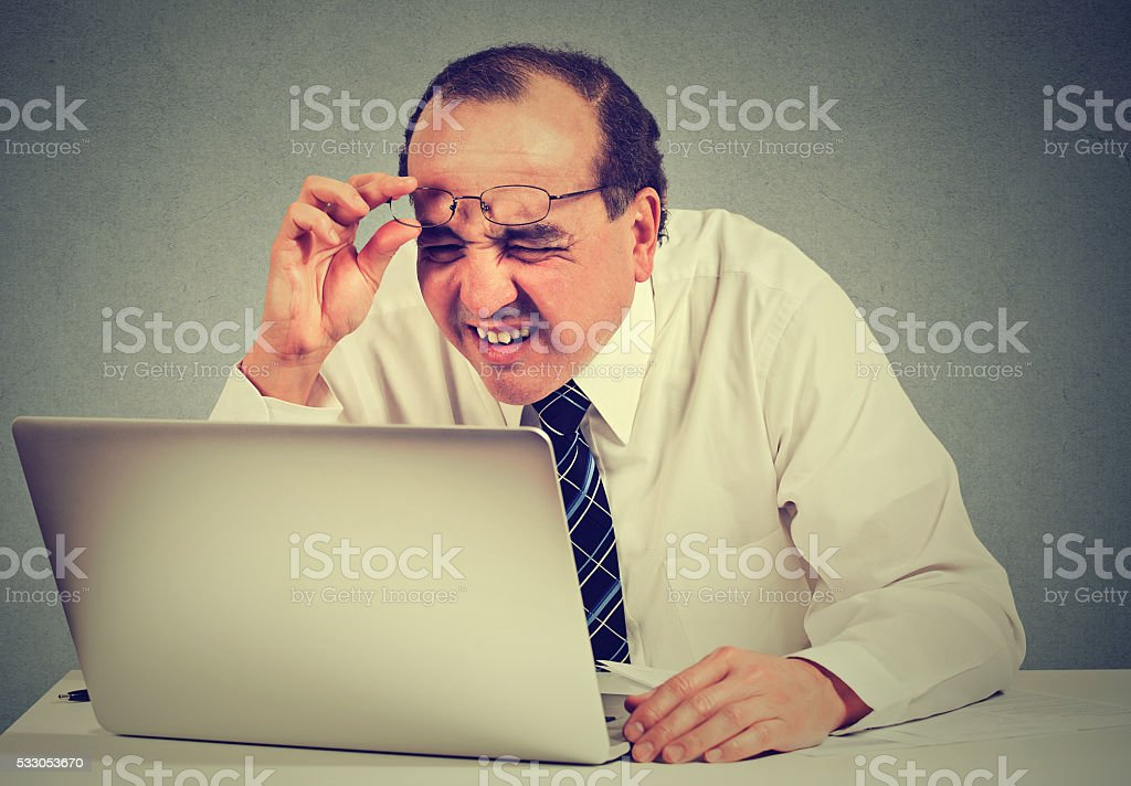 business man with glasses having eyesight problems stock photo