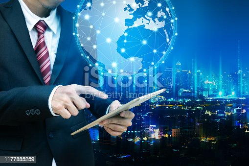 istock Business man with global network connection concept 1177885259