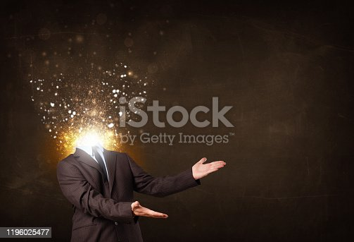 istock Business man with glowing exploding head 1196025477