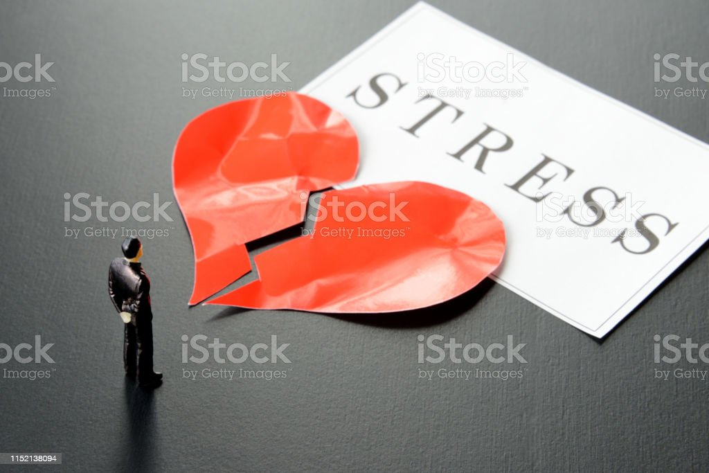 Business man with heart broken by stress