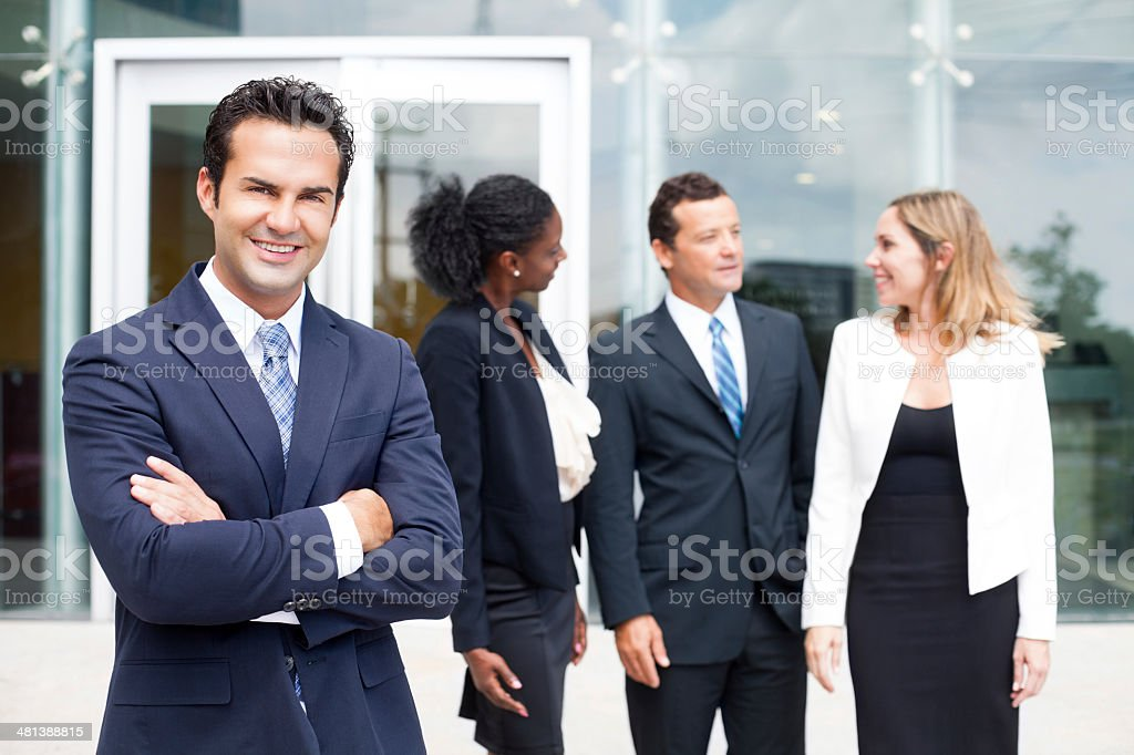 Business man with his arms crossed in front of him stock photo
