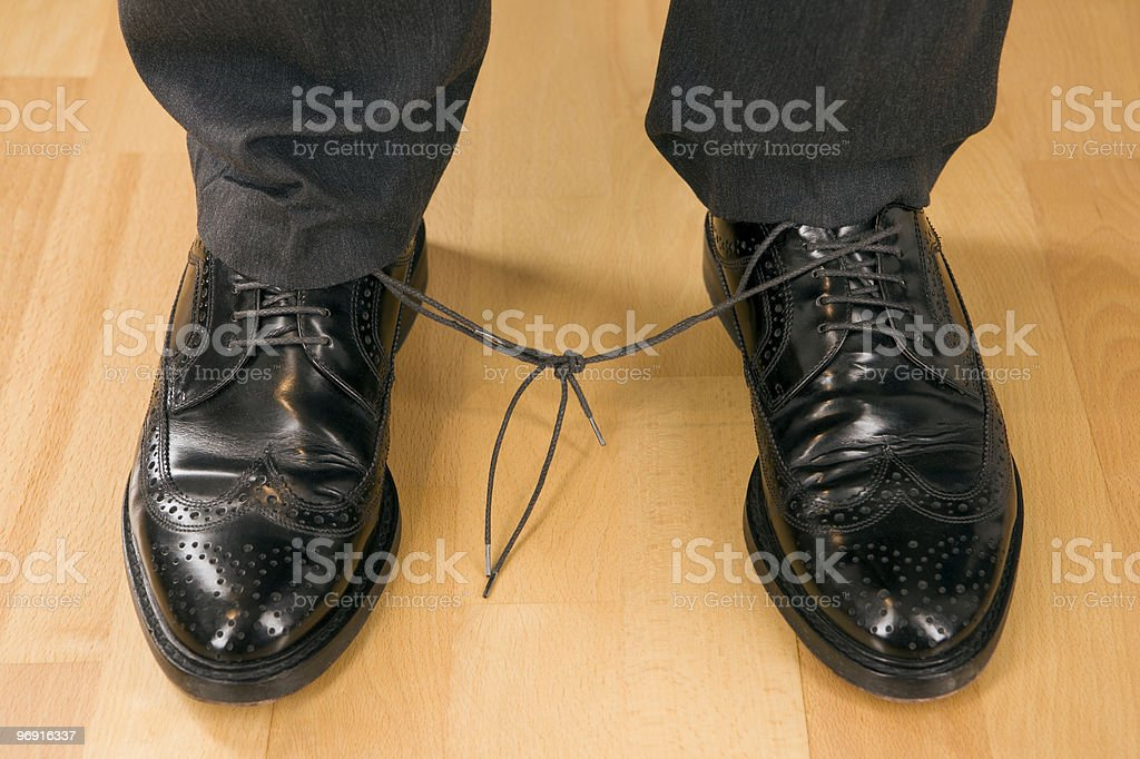 Business man with knotted laces royalty-free stock photo