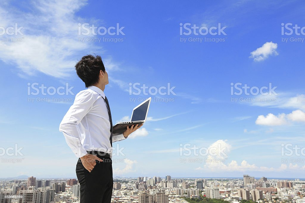 business man with laptop and look sky royalty-free stock photo