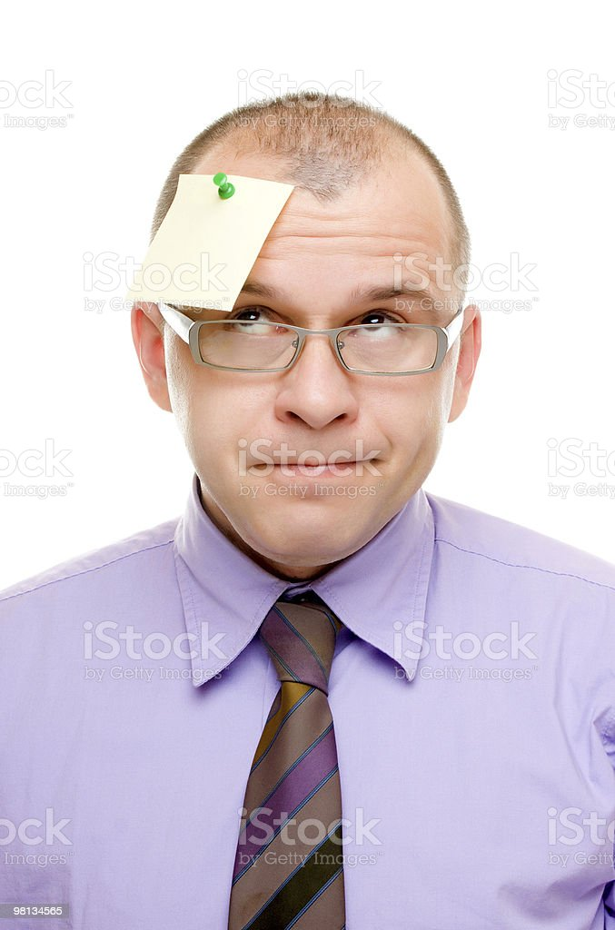 Business man with note pinned on his head royalty-free stock photo
