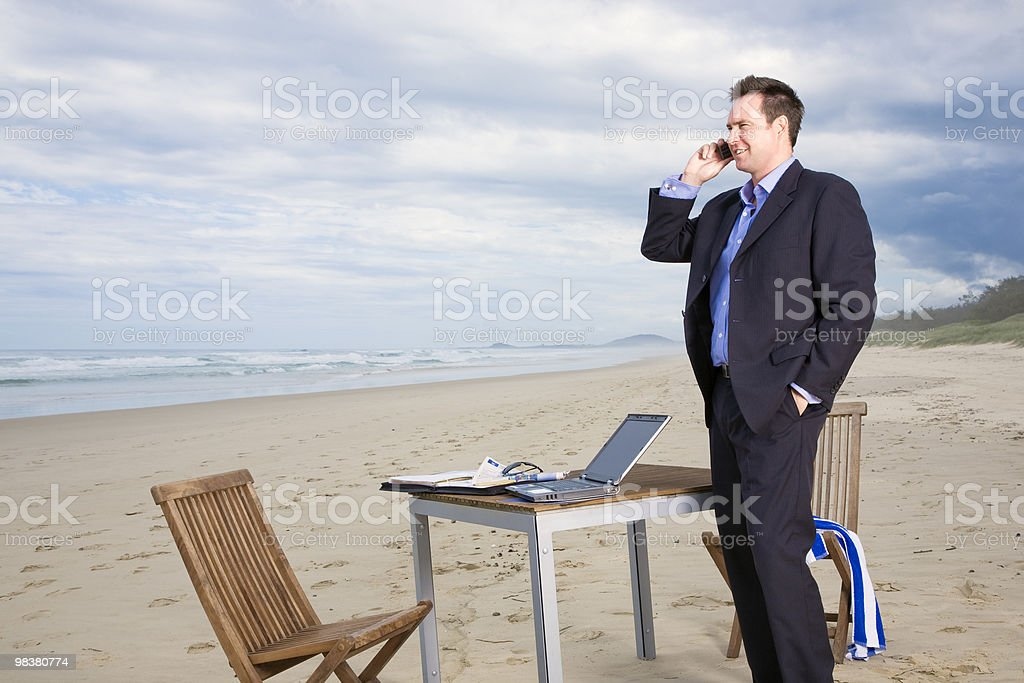 Business man with office on the beach royalty-free stock photo