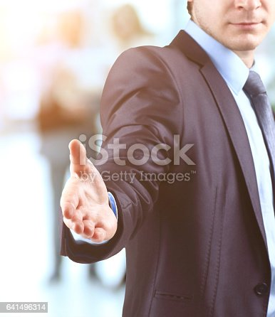 635949862 istock photo Business man with open hand ready to make a deal on the background diskussiya colleagues 641496314