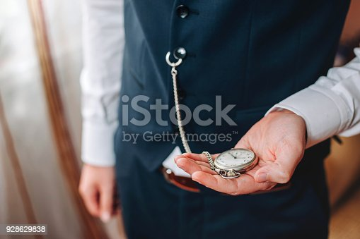 istock Business man with pocketwatch 928629838