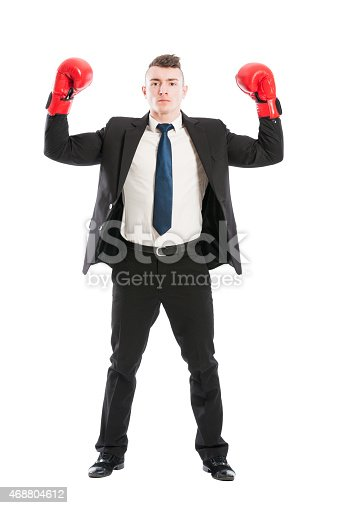 464164875 istock photo Business man with red boxing gloves standing 468804612