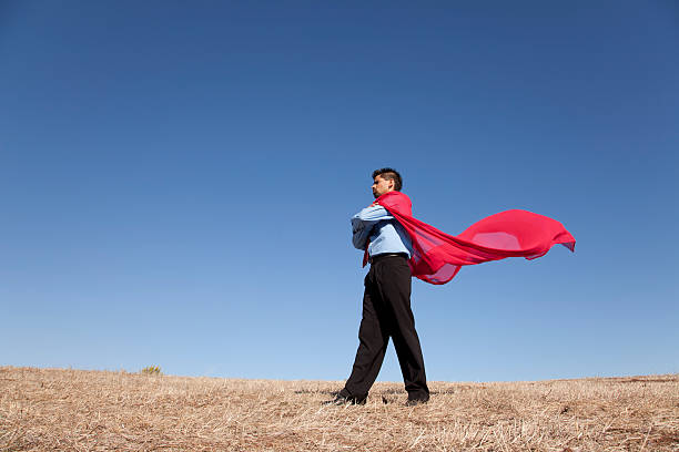 Business man with red hero cape stock photo