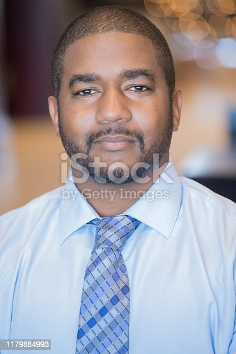 istock Business man with serious look on his face 1179884993